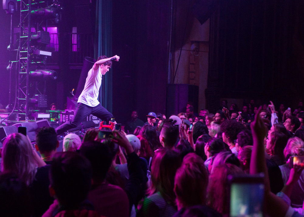 "Rapper and singer Myles Parrish leaps into the crowd and had previously instructed the crowd to make a mosh pit in order for there to be room. Myles opened for Luke Christopher and Hoodie Allen during Hoodie Allen's ""The Hype"" tour named after his new album at The Fonda Theatre in Los Angeles, Calif on Monday, Oct 30th 2017. (Photo by: Thane Fernandes)"