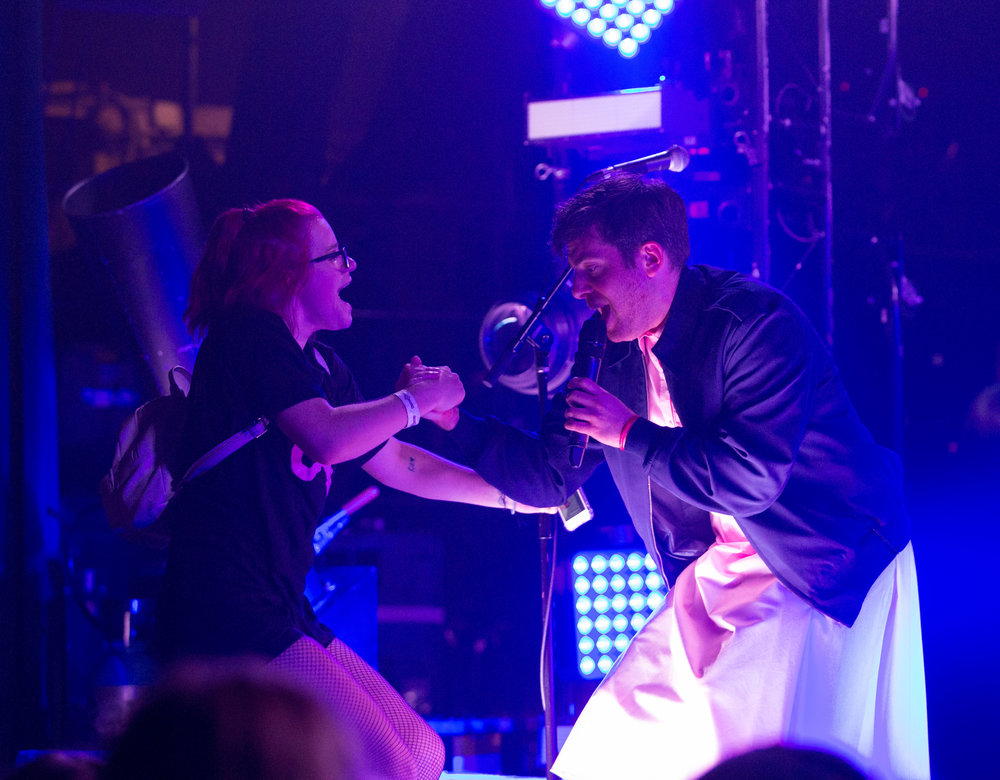 "American rapper Hoodie Allen (Steven Adam Markowitz) helps a fan on stage after her phone was called by the rapper dressed as the female character ""11"" from the Netflix show ""Stranger Things"". The second season of the show released Friday, October 27th and ""11"" is iconically remembered on the show for wearing a dress with a jacket and loving ""Eggo Waffles"", which Hoodie previously threw into the crowd. . Before Hoodie Allen came out to preform a member of his crew informed the crowd that if they texted ""#freehoodie"" to 646-961-3101 and filled out the form they could have a chance of joining the rapper on stage for a free shirt and to announce the next song which was ""Surprise Party"" during ""The Hype"" tour named after his new album at The Fonda Theatre in Los Angeles, Calif on Monday, Oct 30th 2017. (Photo by: Thane Fernandes)"