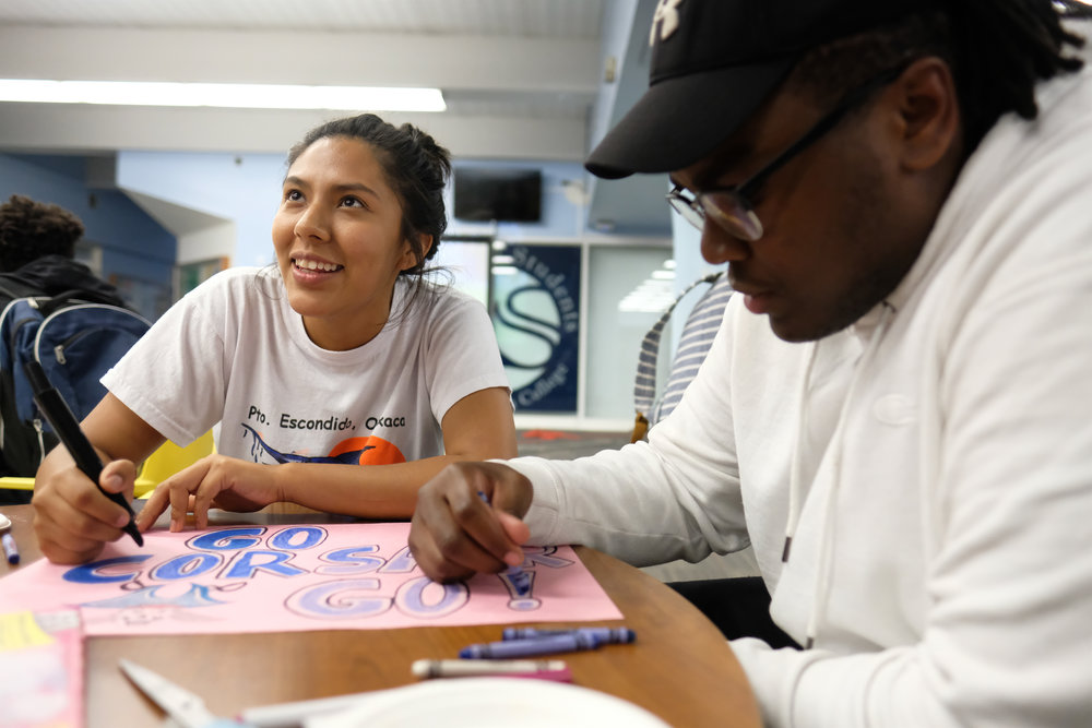 Kimberly Hernandez a student putting the final touches on her poster for the Santa Monica College Spirit Week poster contest in Santa Monica, CALIF on October 30, 2017. (Photo by Jayrol San Jose)
