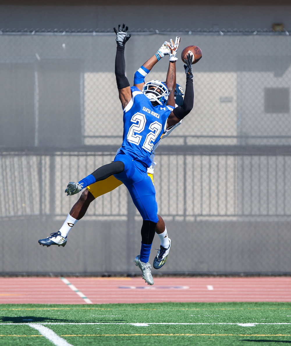 Richard Harbor III (22) of the Santa Monica College jumps up to perform the ball. College of the Canyons beat the Corsairs 48-7. The game was held at the Corsair Stadium at the Santa Monica College Main Campus in Santa Monica, California, on 4th of November, 2017. (Photo by: Elena Rybina)