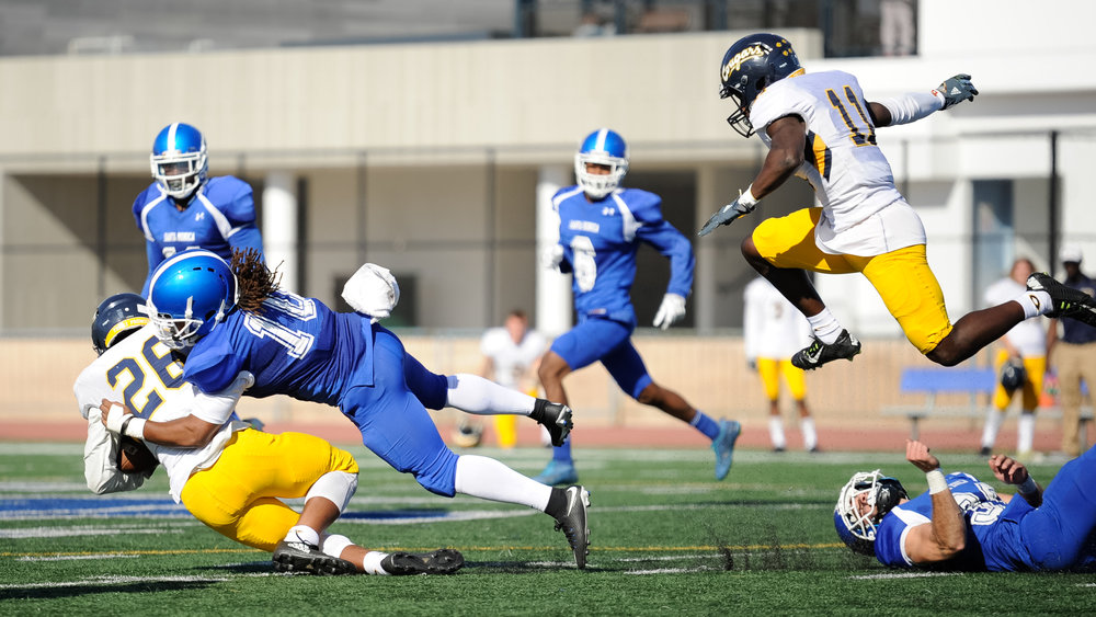 Linebacker Devin Cox (10,Middle) of Santa Monica College tackles running back Jalen Logan (26,Middle) of College of the Canyons ending the play. The Santa Monica College Corsairs lose their final home game 7-48 to the College of the Canyons Cougars and will play their final game of the season away at Moorpark on Saturday, November 11. The game was held at the Corsair Stadium at the Santa Monica College Main Campus in Santa Monica, Calif.. November 4, 2017. (Photo by: Justin Han/Corsair Staff)
