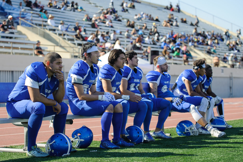 Several Corsairs watch from the sidelines as their teammates attempt to start a rally to recover from the large deficit. The Santa Monica College Corsairs lose their final home game 7-48 to the College of the Canyons Cougars and will play their final game of the season away at Moorpark on Saturday, November 11. The game was held at the Corsair Stadium at the Santa Monica College Main Campus in Santa Monica, Calif.. November 4, 2017. (Photo by: Justin Han/Corsair Staff)
