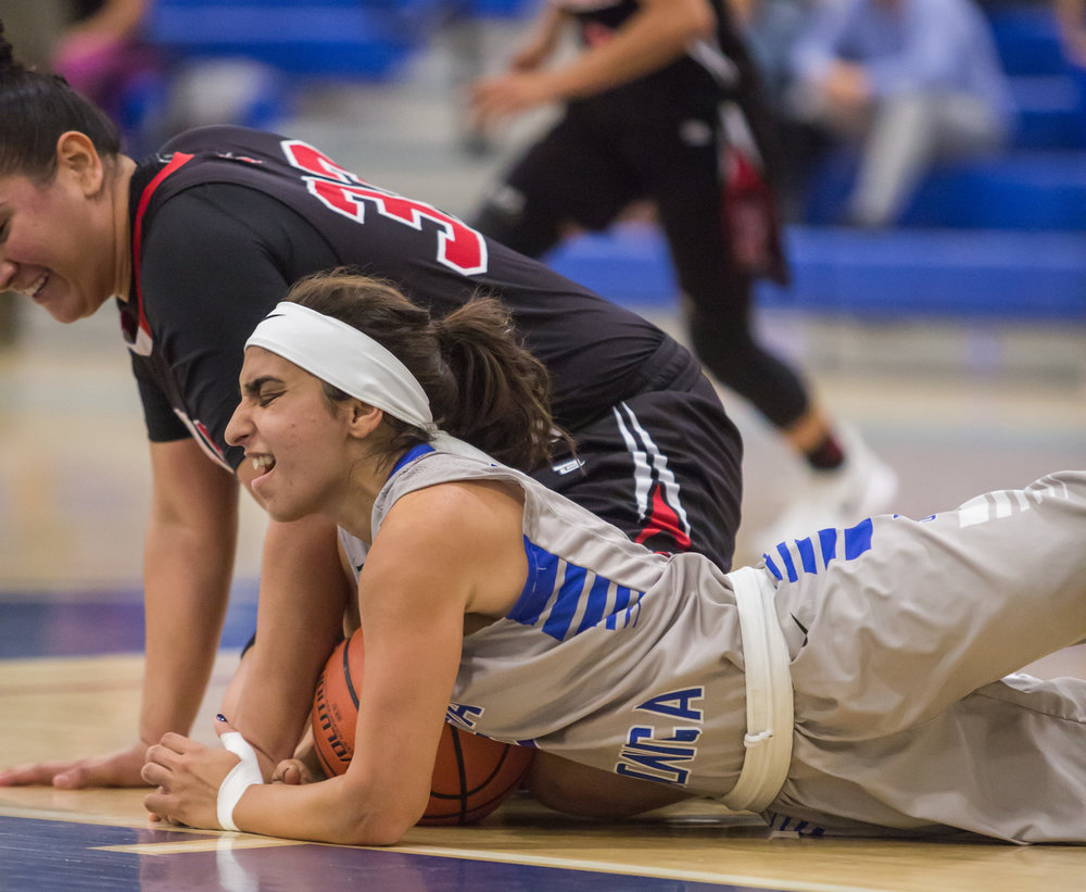 Guard Jessica Melamad (2) of Santa Monica College Corsairs fights for possession of a loose ball against Forward Alexis Casillas (33) of Santa Ana College. Santa Monica College Corsairs win the game 63-54 against Santa Ana College. On Saturday, November 4th, 2017 at the SMC Pavilion on the Santa Monica College Main Campus in Santa Monica, California. (Photo by Yuki Iwamura)