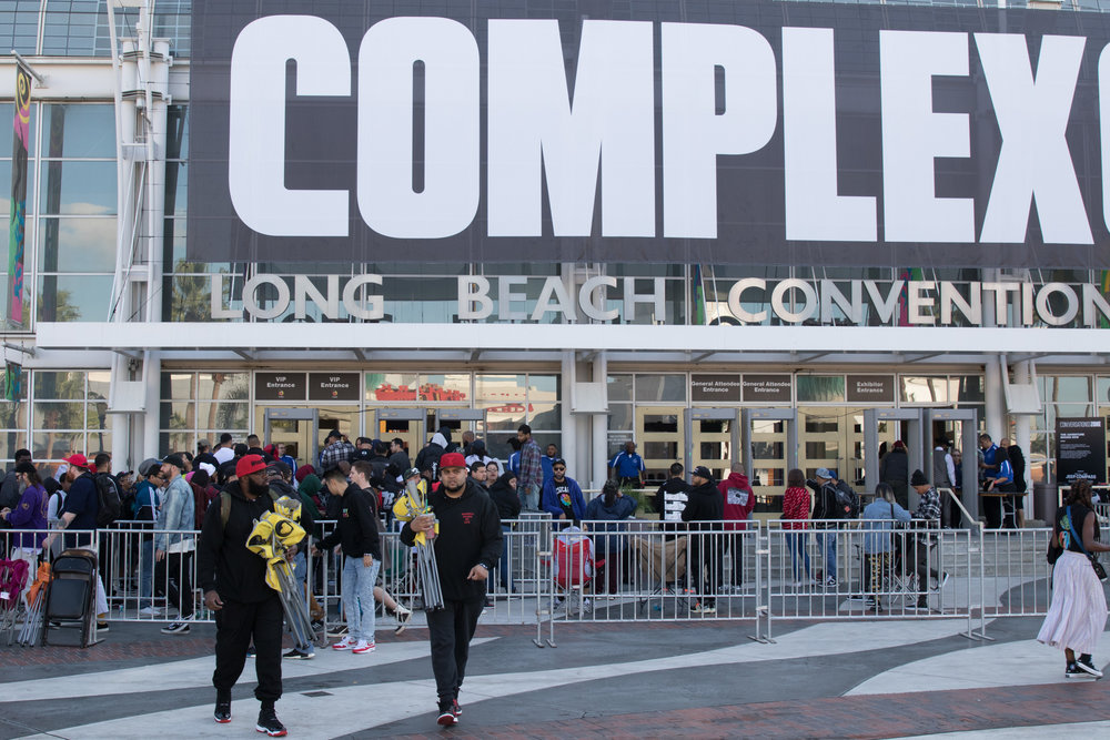 Members of Complex Magazine staff remove blockades as the doors prepare to open at the 2017 Complexcon on November 4, 2017 at the Long Beach Convention Center in Long Beach Calif. (Photo By: Zane Meyer-Thornton)