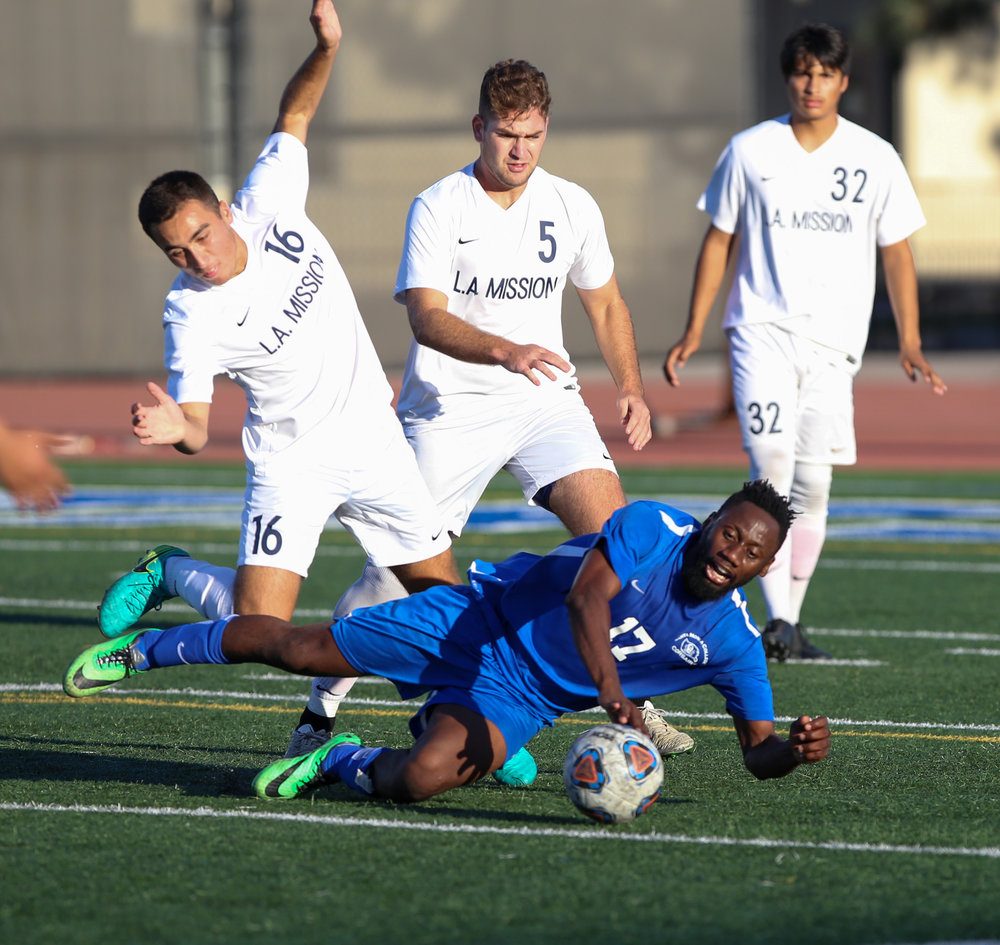 Cyrille Njomo (CQ) (17 middle) tripped when running with the ball  during the soccer game between Santa Monica College's Corsairs and L.A. Mission College's Eagles at the Corsair Stadium at Santa Monica College in Santa Monica, Calif on Tuesday, Nov 7th 2017. The game ended in a win for the Corsairs with a final score of 2-1. (Photo by: Thane Fernandes)