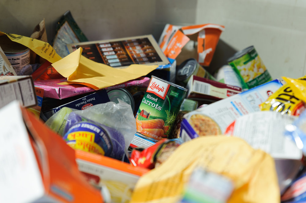Various food items sit in a large crate waiting to be sorted by volunteers of the Westside Food Bank. Volunteers would come help sort through the various loose food items that the food bank receives during donation drives. Westside Food Bank, Santa Monica Calif.. November 9, 2017. (Photo by: Justin Han/Corsair Staff)