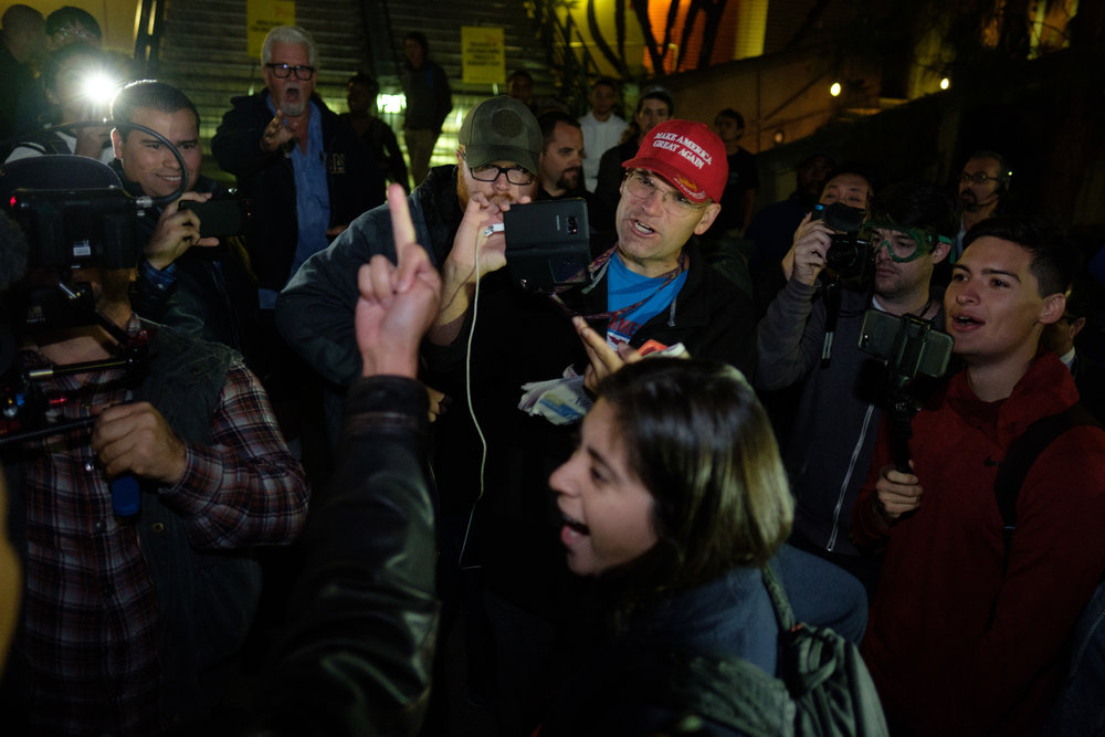 Arthur C. Sharper and other Trump supporters talking to a protester during the Rally Against Hate at UCLA during Ben Shapiros talk taking place in the Ackerman Union building on campus in Los Angeles, CALIF on November 13, 2017. (Photo by Jayrol San Jose)
