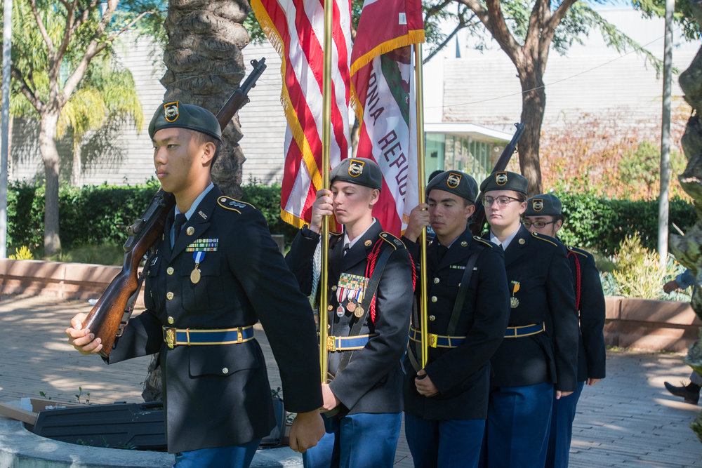 """North High JROTC members present The Colors to begin the """"Honoring Veterans from Veterans"""" event in the Santa Monica Main Campus quad located in Santa Monica College in Santa Monica, Calif.  Photo by: Rosangelica Vizcarra"""