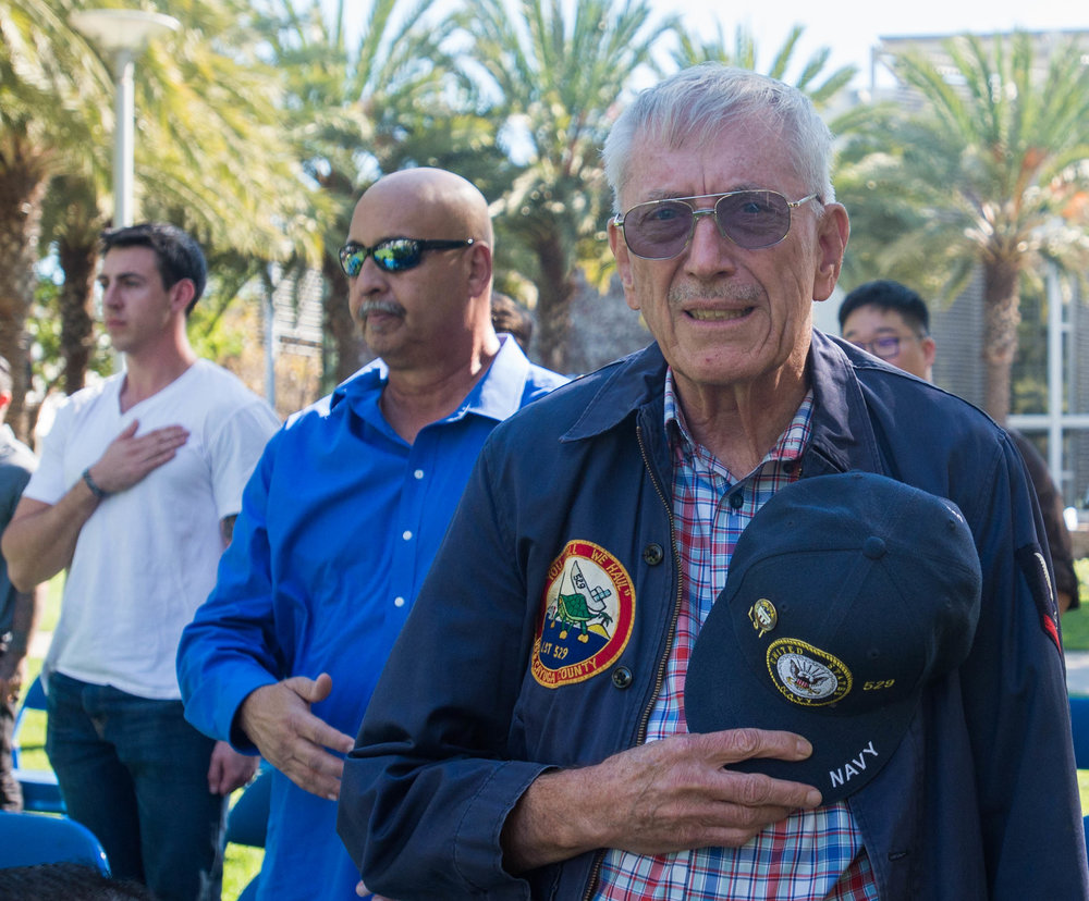"""Fred Zimmerman, Veteran of the U.S. Navy, stands during the Pledge of Allegiance during the """"Honoring Veterans from Veterans"""" event in Santa Monica Main Campus quad located in Santa Monica College in Santa Monica, Calif. Zimmerman was in-between Korean and Vietnam serving as an Electric Technician. Photo by: Rosangelica Vizcarra"""