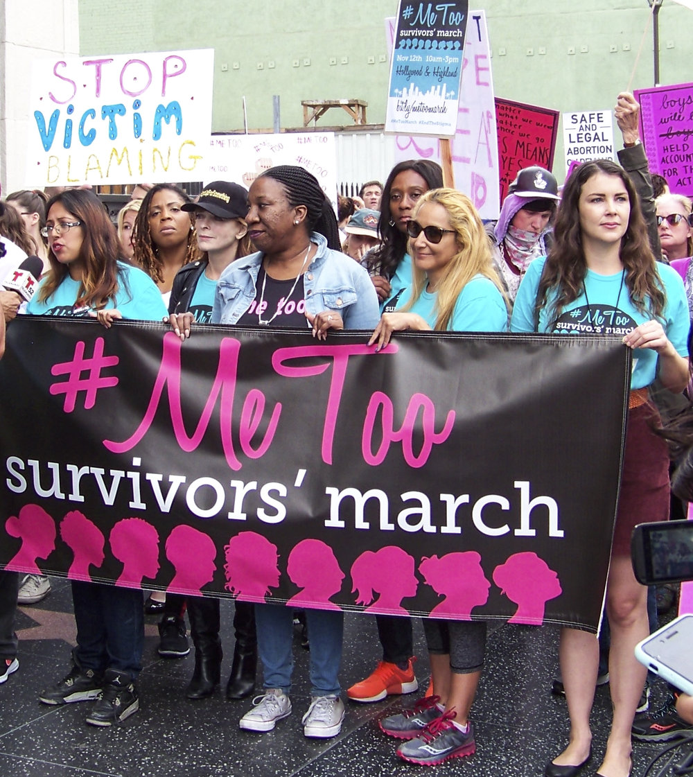 Me Too founder Tarana Burke (center) and founder of the #MeToo Movement leads the large group of sexual violence protesters down Hollywood Blvd in Hollywood, Calif. on November 12, 2017. (Photo by Jakob Zermeno)