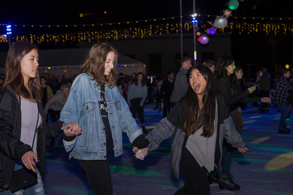 (L to R) Friends Lisa Bang, Alexandra Shambayate and Judy Chhoeung share laughs while holding hands and skating on the rink at the Grand Opening Ceremony for Ice at Santa Monica in Santa Monica, Calif., November 8, 2017. (Photo By: Ripsime Avetisyan/Corsair Staff)