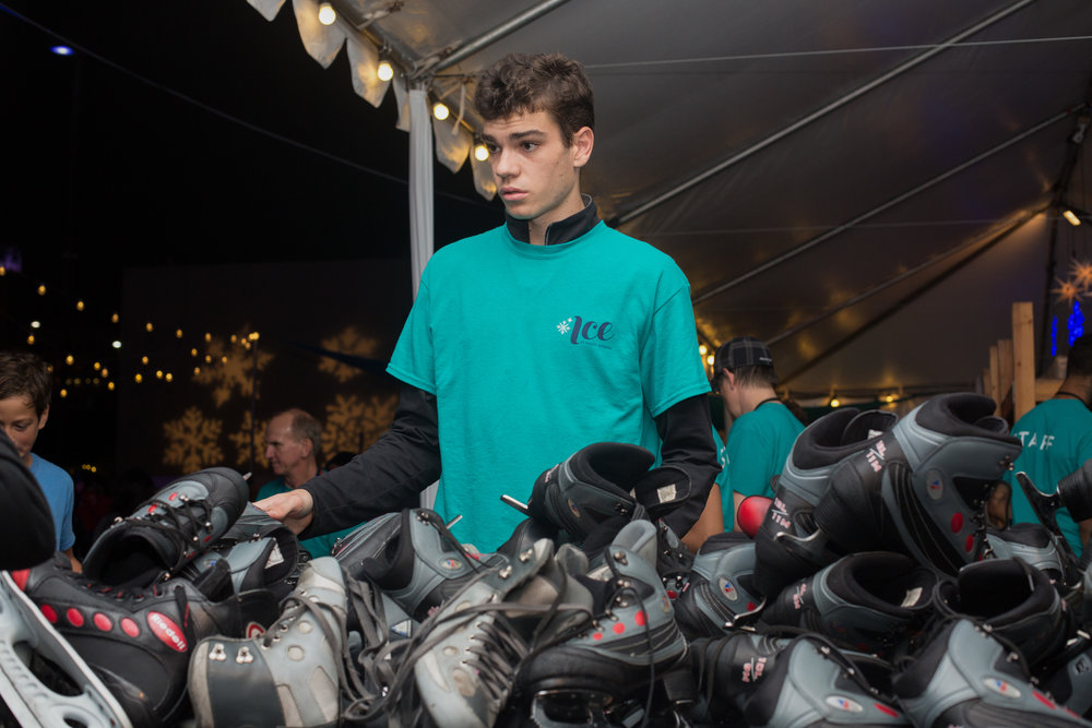 Ice at Santa Monica worker Max Posell organizes returned ice skates at the Grand Opening Ceremony for Ice at Santa Monica in Santa Monica, Calif., November 8, 2017. (Photo By: Ripsime Avetisyan/Corsair Staff)