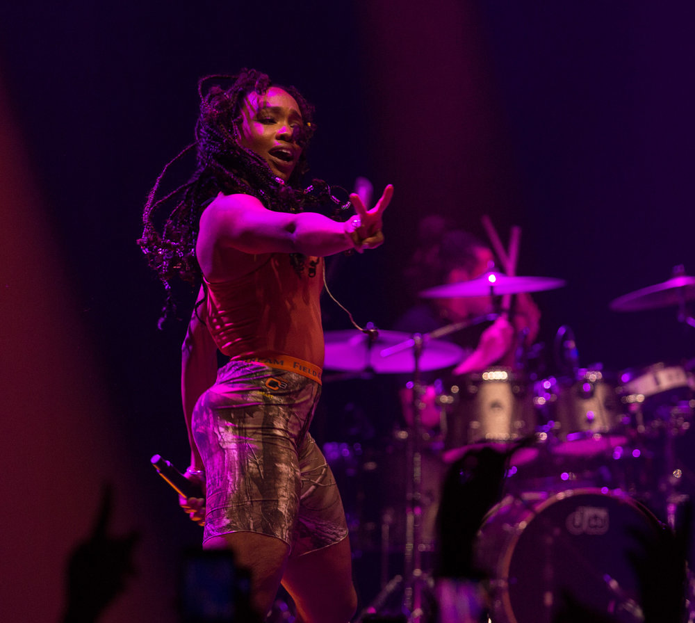 "American R&B singer Solána Imani Rowe ""SZA"" puts up two fingers as she dances on stage during her performance of ""Prom"" off of her debut album ""Ctrl"" at the Novo in Los Angeles, Calif. on Tuesday, Nov. 14, 2017. The show was not originally on SZA's ""Ctrl"" tour but was recently added due to high demand. Photo by Thane Fernandes."