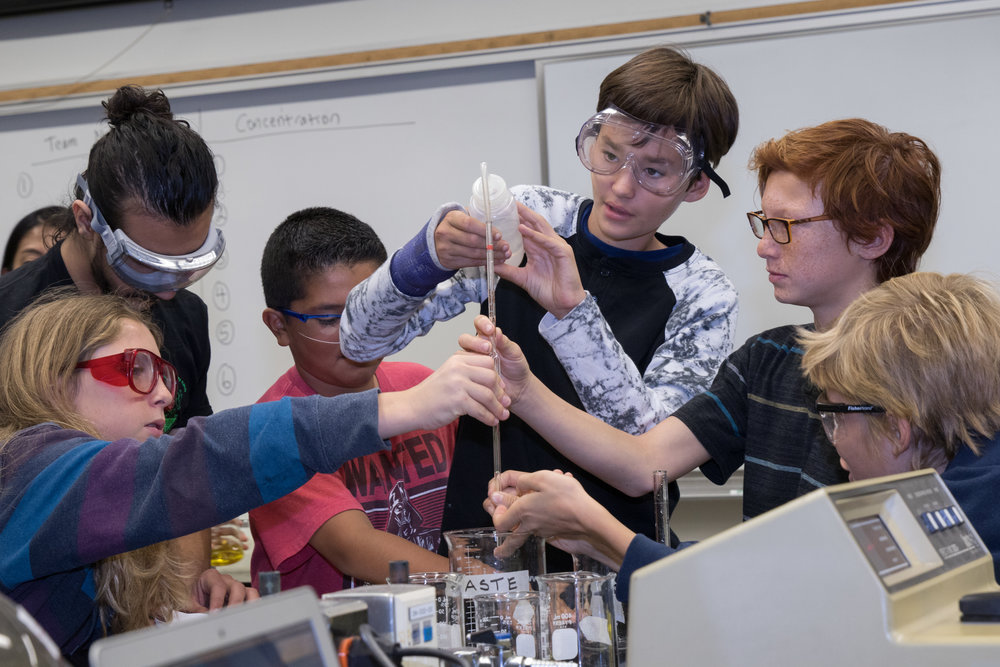 Students from John Adams Middle School conduct their assigned experiment as part of a Santa Monica College Chemistry Club outreach event. The event took place on the Santa Monica College main campus in Santa Monica, Calif. on November 18, 2017. (Photo By: Zane Meyer-Thornton)