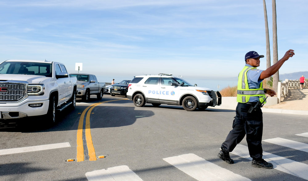 Santa Monica Police directing traffic at the intersection of Ocean Avenue and California Ave. Traffic was being diverted because of a fatal car accident on the morning of November 21, 2017 in Santa Monica, CA. (Photo by Jayrol San Jose)