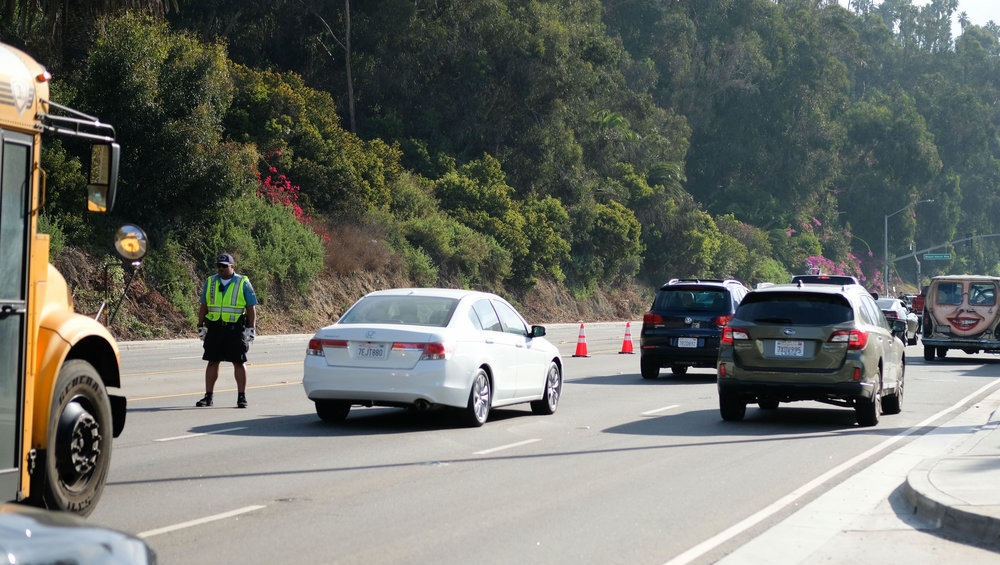 Traffic Officer directing traffic on Pacific Coast Highway  1. The highway going Northbound was shut down due to a fatal car accident on November 21, 2017 in Santa Monica, CALIF.(Photo by Jayrol San Jose)