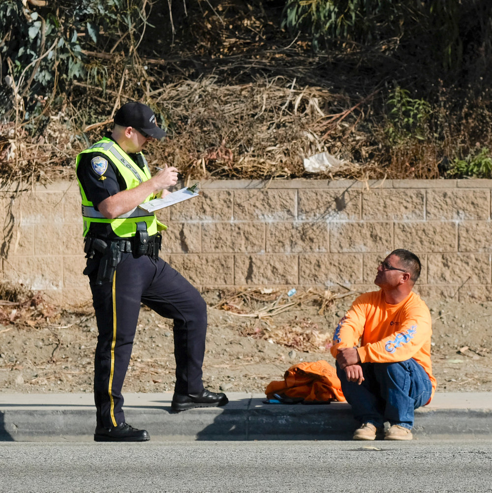 Santa Monica Police Officer conducting an investiagation with person who was involved in the accidenton November 21, 2017 in Santa Monica, CALIF. (Photo by Jayrol San Jose)