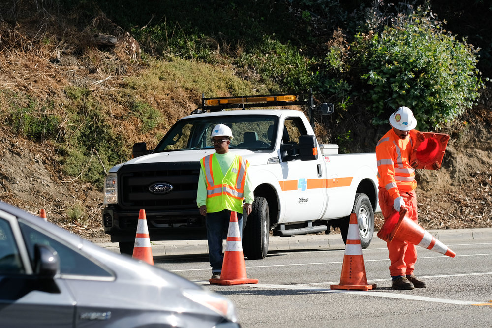 Traffic controllers helping out by placing orange cones stopping any traffic trying to go Northbound on the Pacific Coast Highway 1 on November 21,2017 in Santa Monica, CALIF. (Photo by Jayrol San Jose)