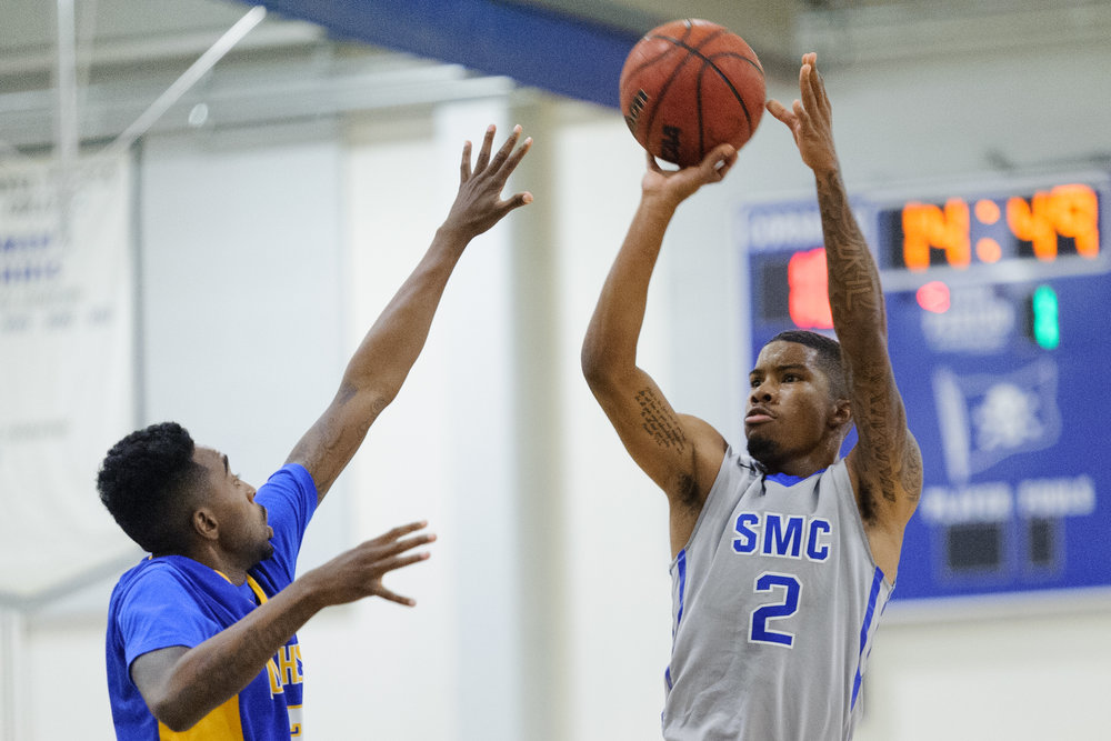 Guard Joe Robinson (2,Right) of the Santa Monica College takes a shot attempt while being contested by guard D'Lano Beckles (3,Left) of Southwest College. The Santa Monica College Corsairs win their first home game of the season 84-53 against the Southwest College Cougars. The game was held at the SMC Pavilion at the Santa Monica College Main Campus in Santa Monica, Calif.. November 21, 2017.(Photo by: Justin Han/Corsair Staff)