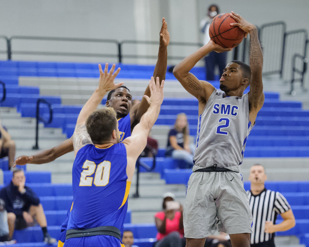 Guard Joe Robinson (2,Right) of the Santa Monica College takes a shot attempt while being contested by guards Austin Toomalatai (20,Left) and Kiza Sekiyoba (1,back) of Southwest College. The Santa Monica College Corsairs win their first home game of the season 84-53 against the Southwest College Cougars. The game was held at the SMC Pavilion at the Santa Monica College Main Campus in Santa Monica, Calif.. November 21, 2017.(Photo by: Justin Han/Corsair Staff)