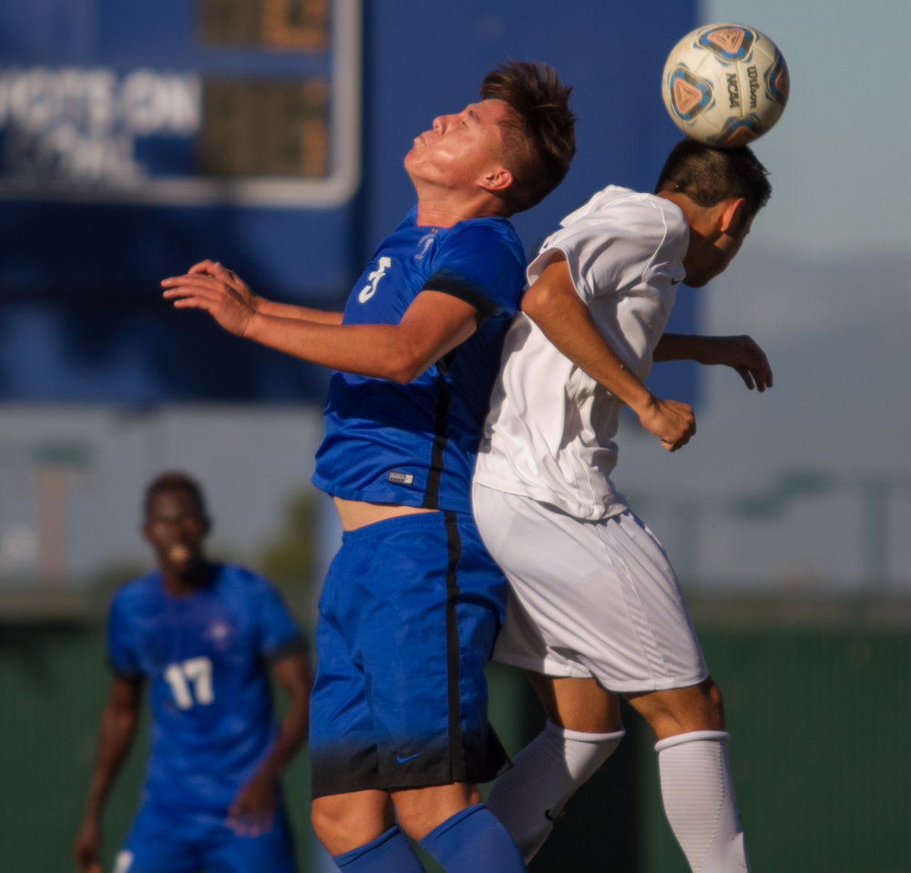 Santa Monica College Corsair Carlos Rincon (16)(R) contests a header against Cerritos College Falcon Luis Lira (5)(L) on Wednesday, November 22, 2017, at Cerritos College in Norwalk, California. The Corsairs lose 2-1. (Josue Martinez)