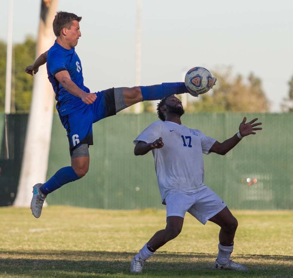Santa Monica College Corsair Cyrille Njomo (17)(R) contests the ball against Cerritos College Falcon Esteban Camacho (6)(L) on Wednesday, November 22, 2017, at Cerritos College in Norwalk, California. The Corsairs lose 2-1. (Josue Martinez)
