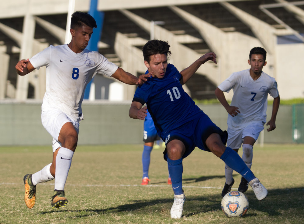 Santa Monica College Corsair Andy Naidu (8)(R) fights for possession of the ball against Cerritos College Falcon (10)(R) on Wednesday, November 22, 2017, at Cerritos College in Norwalk, California. The Corsairs lose 2-1. (Josue Martinez)