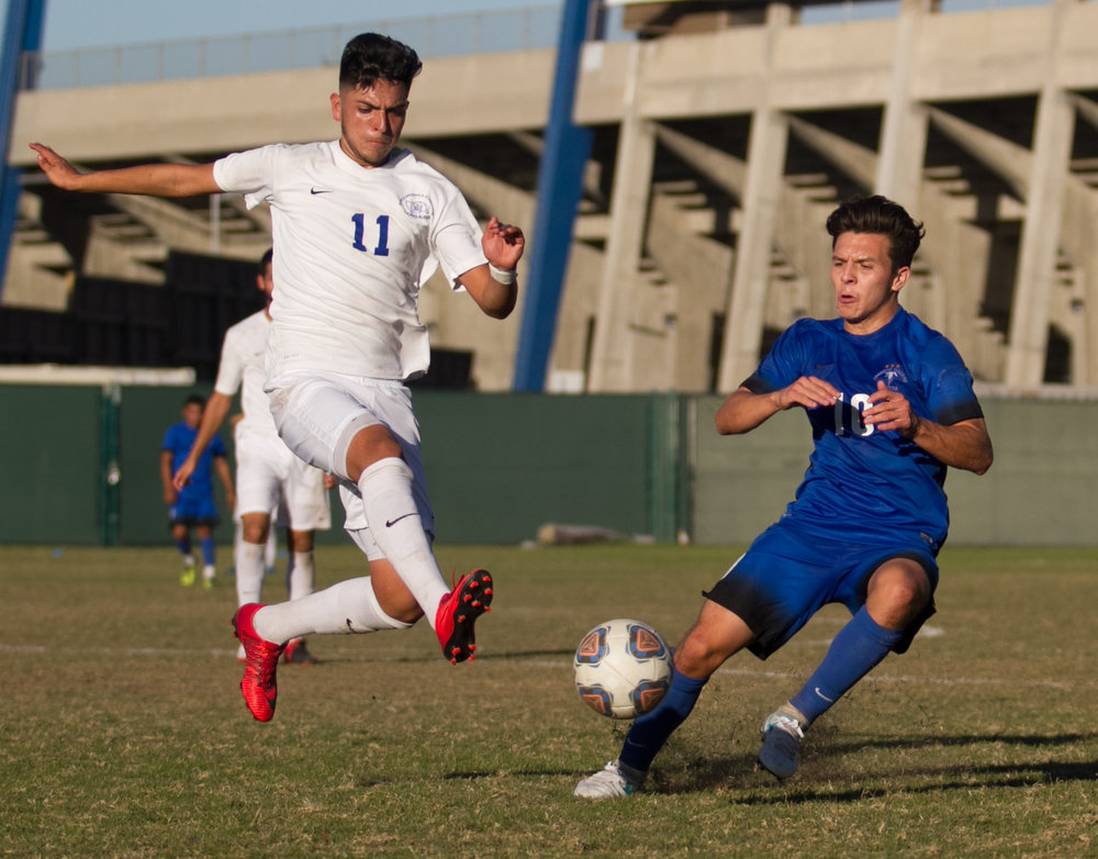 Santa Monica College Corsair Danny Hernandez (11)(L) fights for possession of the ball against Cerritos College Falcon Luis Garcia (10)(R) on Wednesday, November 22, 2017, at Cerritos College in Norwalk, California. The Corsairs lose 2-1. (Josue Martinez)