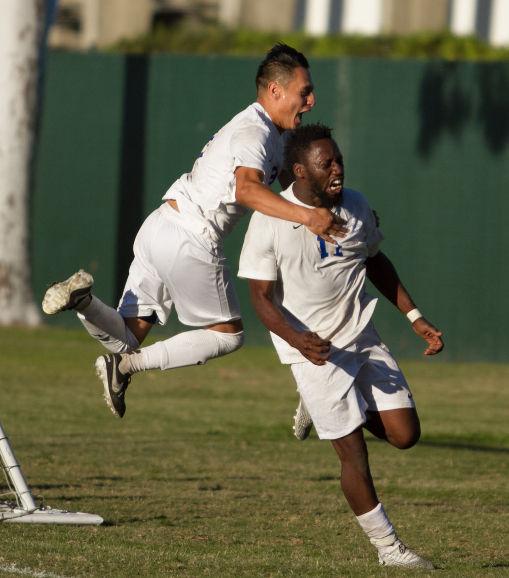 Santa Monica College Corsair Cyrille Njomo (17)(R) celebrates after scoring a goal with his teammate Chris Negrete (9)(L) during the match against Cerritos College on Wednesday, November 22, 2017, at Cerritos College in Norwalk, California. The Corsairs lose 2-1. (Josue Martinez)