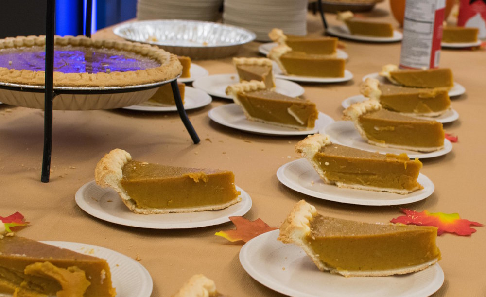 Pumpkin pie is given out to students during a 'Friendsgiving' dinner on Nov. 21 in the Santa Monica College cafeteria at Santa Monica, Calif. The event was hosted by the Asian Culture Exchange Association, a club on campus that wanted a night to bring students and faculty together with a traditional American Thanksgiving. (Photo by Ethan Lauren)