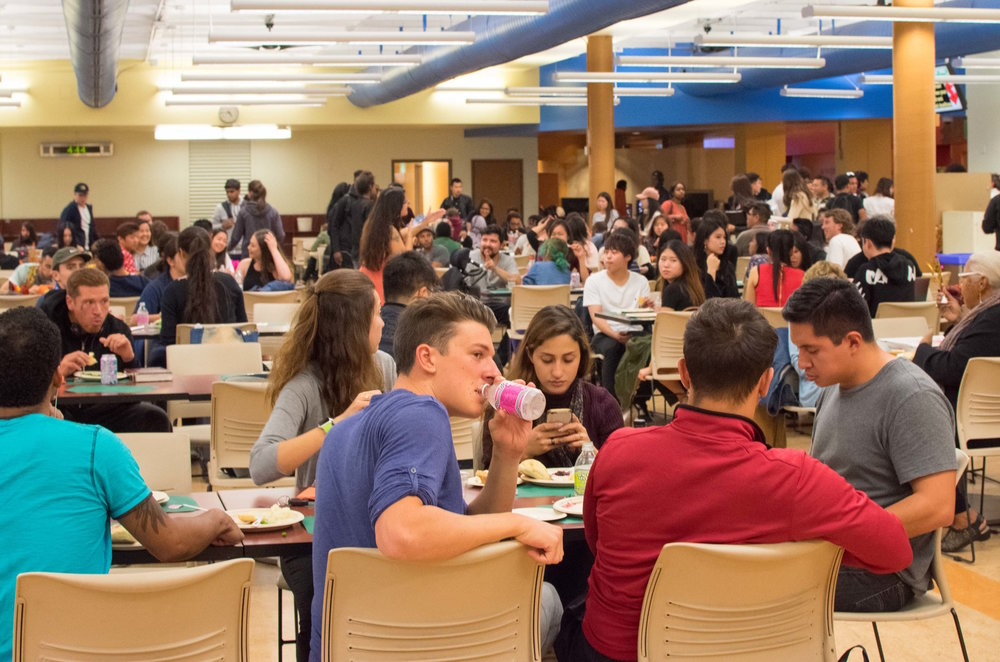 Students sit down and enjoy a free 'Friendsgiving' dinner on Nov. 21 in the Santa Monica College cafeteria at Santa Monica, Calif. The event was hosted by the Asian Culture Exchange Association, a club on campus that wanted a night to bring students and faculty together with a traditional American Thanksgiving. (Photo by Ethan Lauren)