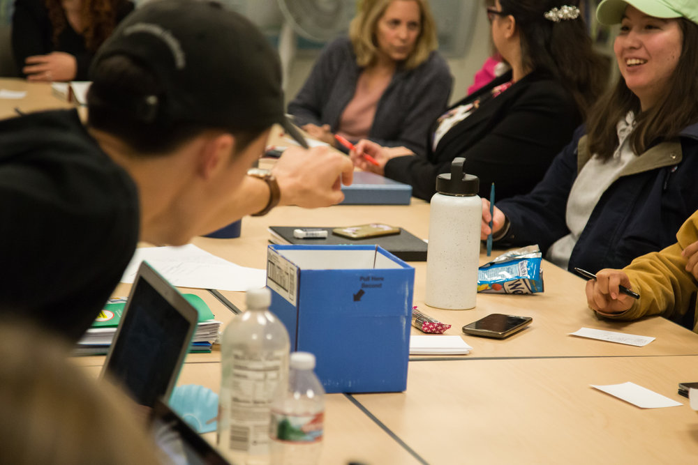 Student put a sheet of question about Gender Equity and Social Justice Center into the box during GEN-C Commitee Meeting on Tuesday, December 5th, 2017 at Humanities & Social Sciences Building in Santa Monica College Main Campus in Santa Monica, California. (Photo by Yuki Iwamura)