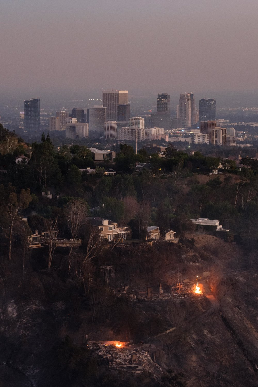 Houses turned to rubble by the Skirball Fire that started in the early morning in Los Angeles, Calif. On Dec. 6, 2017. (Photo by Jayrol San Jose)