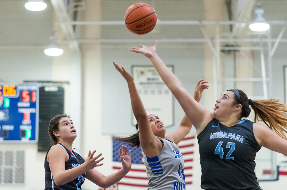 Forward Angelina Moreno (14,Center) of Santa Monica College makes a shot attempt but is blocked by center Barbara Rangel (42,Right) of Moorpark College. The Santa Monica College Corsairs lose the game 52-69 to the Moorpark College Raiders. The game was held at the SMC Pavilion at the Santa Monica College Main Campus in Santa Monica, Calif.. December 9, 2017. (Photo by: Justin Han/Corsair Staff)