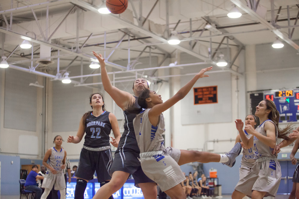 Jazzmina Oddie (12) of the Santa Monica College takes a shot attempt while being contested by guard Barbara Rangel (42) of the Moonpark College. The Santa Monica College Corsairs loss the home game 52-69 against the Moonpark College. The game held on Saturday, December 9th, 2017 at Santa Monica College Pavilion at Santa Monica College Main Campus in Santa Monica, California. (Photo by Elena Rybina)