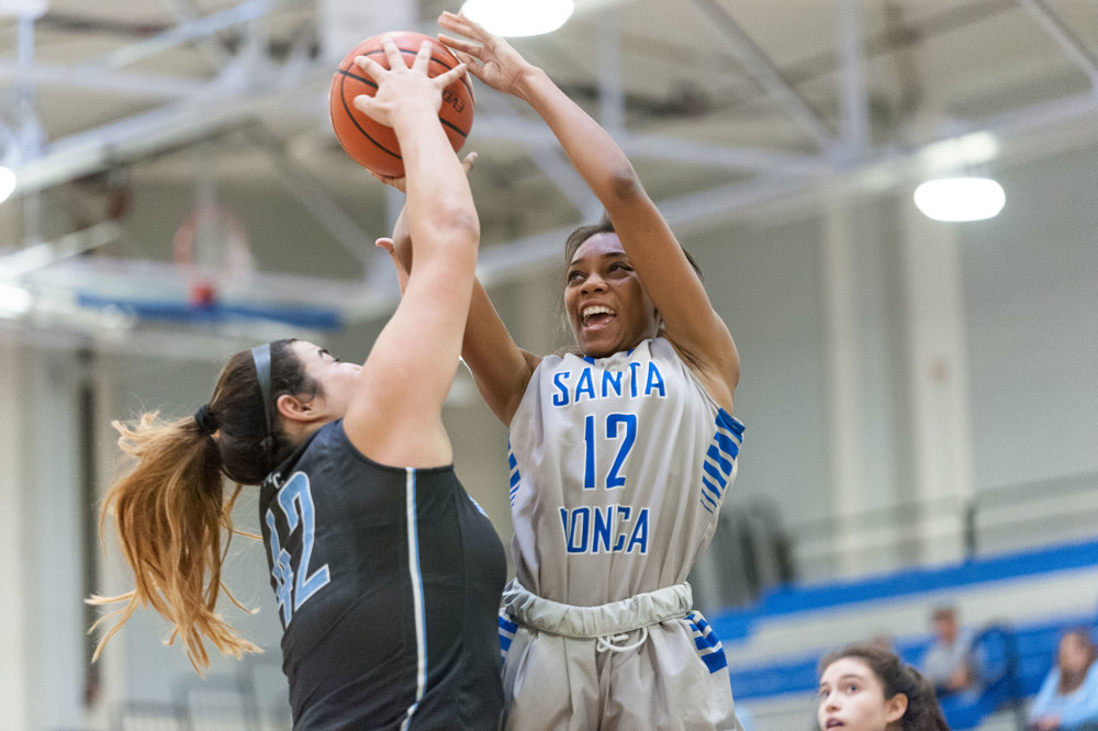 Forward Jazzmin Oddie (12,Right) of Santa Monica College attempts to shoot a contested jumpshot but is blocked by center Barbara Rangel (42,Left) of Moorpark College. The Santa Monica College Corsairs lose the game 52-69 to the Moorpark College Raiders. The game was held at the SMC Pavilion at the Santa Monica College Main Campus in Santa Monica, Calif.. December 9, 2017. (Photo by: Justin Han/Corsair Staff)