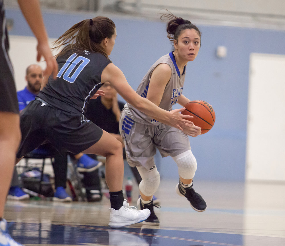 Maylene Cabral (20) of the Santa Monica College to try bypass a guard Emily Herring (10) of the Moonpark College.  The Santa Monica College Corsairs loss the home game 52-69 against the Moonpark College. The game held on Saturday, December 9th, 2017 at Santa Monica College Pavilion at Santa Monica College Main Campus in Santa Monica, California. (Photo by Elena Rybina)