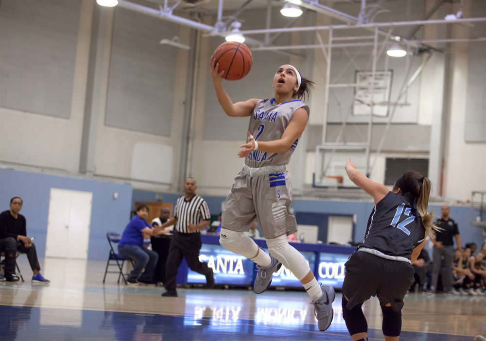Jessica Melamed (2) the Santa Monica College takes a jumpshot while being contested by guard Sydney Arikawa (12) of the Moonpark College. The Santa Monica College Corsairs loss the home game 52-69 against the Moonpark College. The game held on Saturday, December 9th, 2017 at Santa Monica College Pavilion at Santa Monica College Main Campus in Santa Monica, California. (Photo by Elena Rybina)