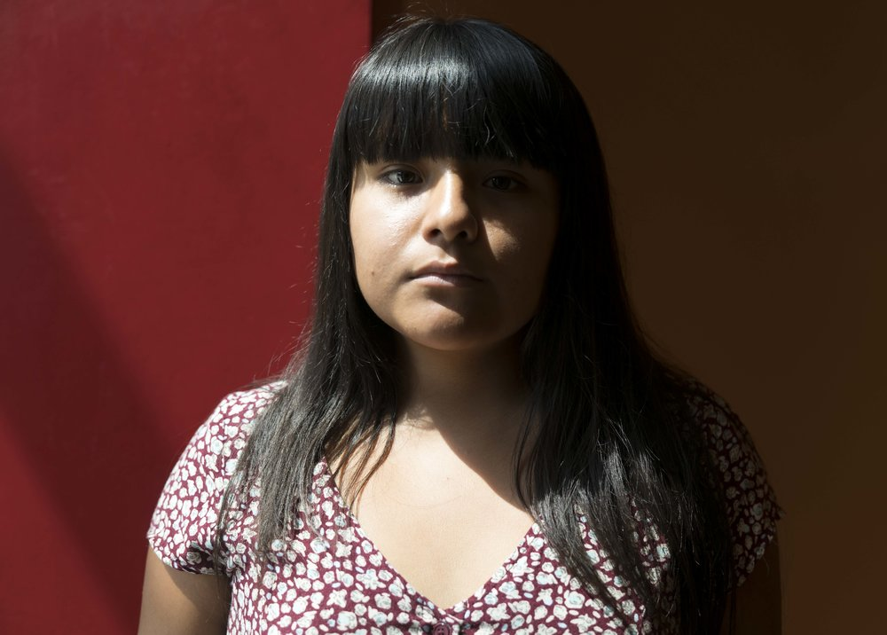 "Santa Monica College student and activist, Salma Aguilar Morales, an undocumented immigrant and DACA recipient in the Santa Monica College cafeteria in Santa Monica, Calif. on September 8, 2017. ""I was never ashamed or scared of it [being undocumented],"" she says, admitting that she tried not to think a lot about it growing up. Aguilar Morales was in middle school when she learned she was an undocumented immigrant. ""I wondered why I didn't have a social security number and why I couldn't visit my family in Mexico like my cousins did,"" she says. (Photo: Helena Sung)"