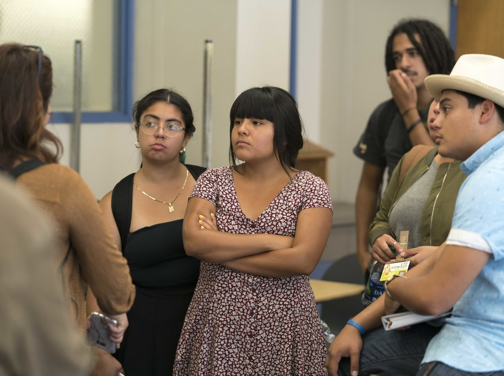 "Santa Monica College student, Salma Aguilar Morales (center), stands in a classroom at Santa Monica College in Santa Monica, Calif. on Friday, September 8, 2017. Aguilar Morales and other Santa Monica College students were finishing a meeting to plan festivities for an upcoming Day of the Dead celebration to be held on campus in early November when student Maria Padilla-Badillo (left), a student activist, informed the group that one of their fellow student activists has been receiving death threats from white supremacists on Facebook for speaking out about being undocumented and for protesting President Donald Trump's decision to end the DACA program. ""Be careful and set your social media accounts to private,"" urged Padilla-Badillo. (Photo: Helena Sung)"