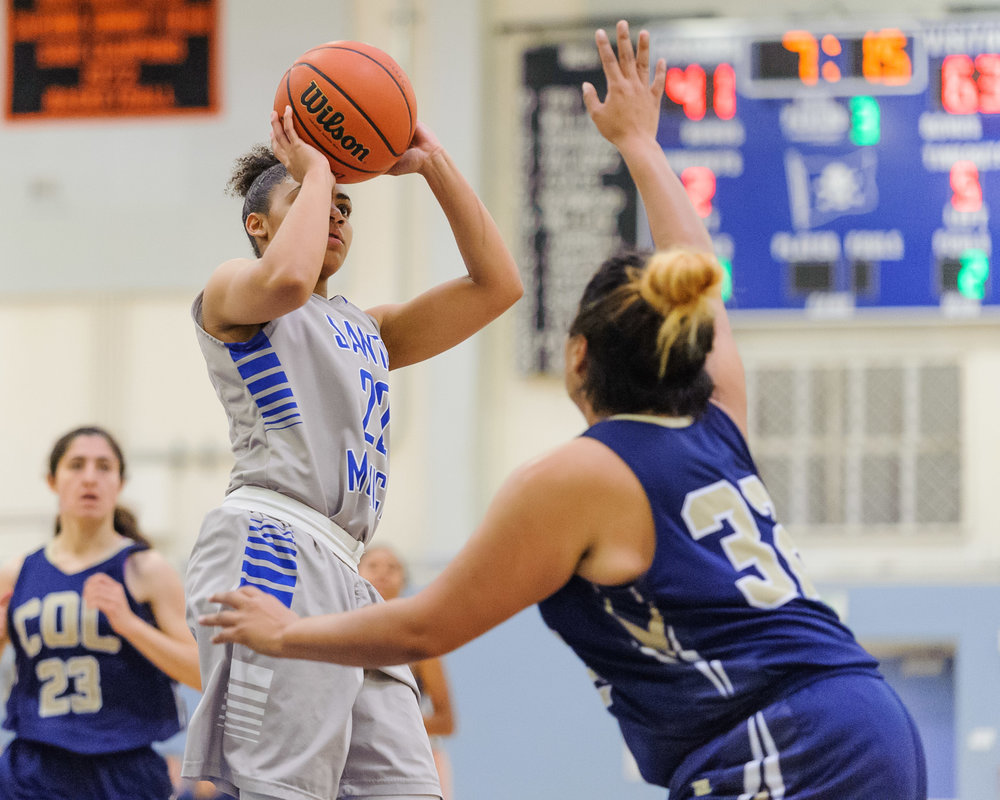 Jinea Cole (22,Left) of Santa Monica College goes up for a shot attempt as Janeth Cruz (32,Right) of the College of the Canyons closes in to contest Cole. The Santa Monica College Corsairs lose the game 108-70 to the College of the Canyons Cougars. The game was held at the SMC Pavilion at the Santa Monica College Main Campus in Santa Monica, Calif.. February 10, 2018. (Photo by: Justin Han/Corsair Staff)
