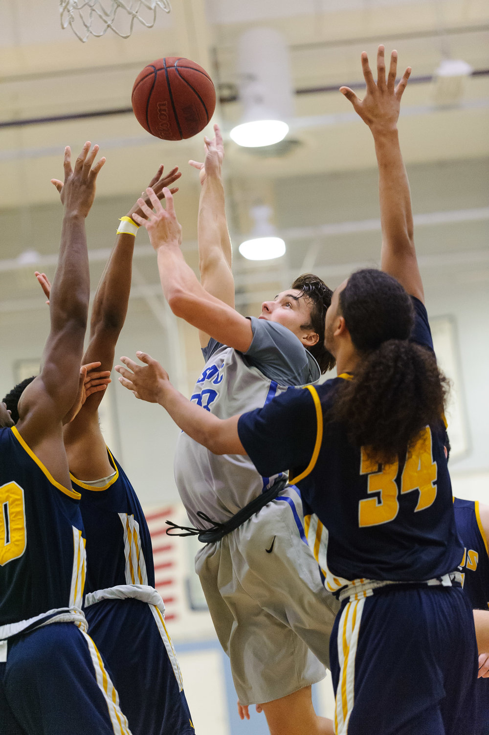 Forward Dayne Downey (23,Middle) of Santa Monica College goes up for a shot attempt by the basket while contested by College of the Canyons defense. The Santa Monica College Corsairs lose the game 74-72 to the College of the Canyons Cougars. The game was held at the SMC Pavilion at the Santa Monica College Main Campus in Santa Monica, Calif.. February 10, 2018. (Photo by: Justin Han/Corsair Staff)