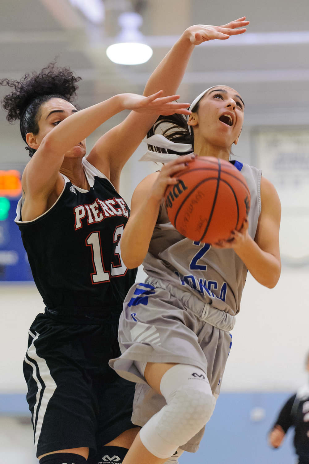 Guard Jessica Melamed (2,Right) of Santa Monica College attempts a difficult shot contested by Diana Kohanzad (13,Left) of Pierce College. The Santa Monica College Corsairs win their final game of the season 76-53 against the Pierce College Brahmas. The game was held at the SMC Pavilion at the Santa Monica College Main Campus in Santa Monica, Calif.. February 17, 2018. (Photo by: Justin Han/Corsair Staff)