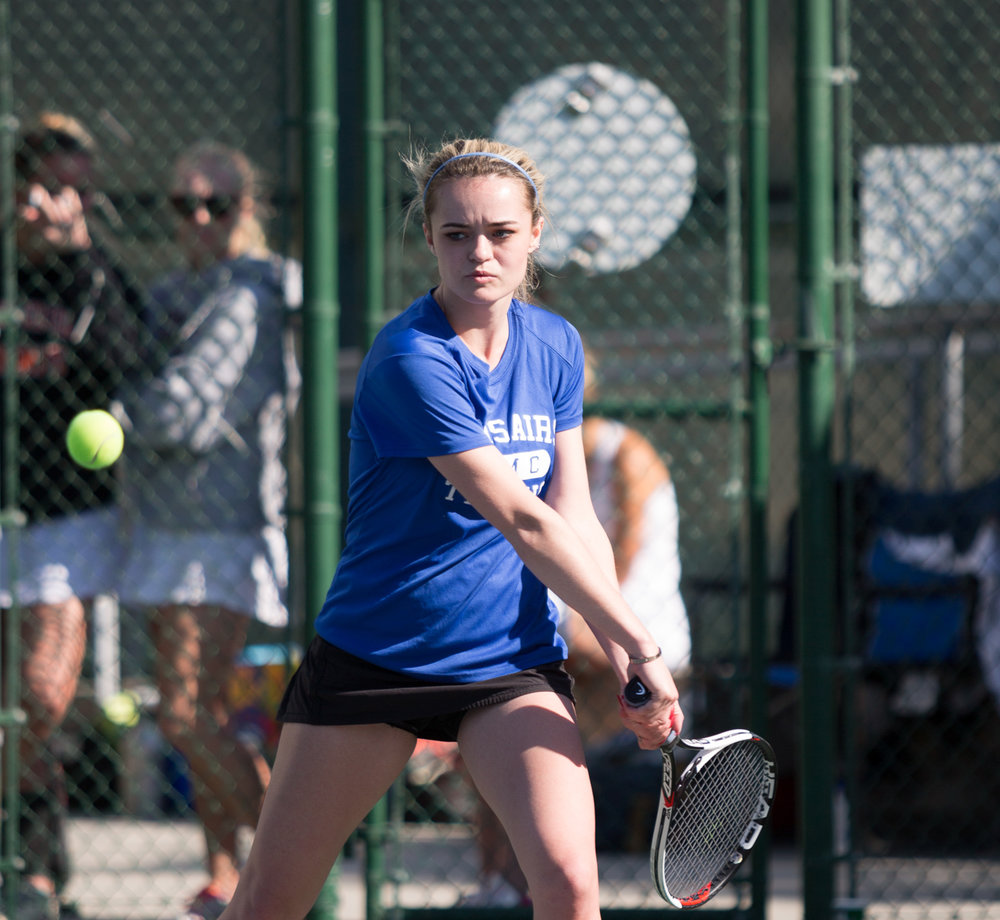 Santa Monica College Corsair sophomore Abby Mullins (#1, singles) prepares to hit a powerful backhand shot at her Ventura College opponent during her 2 – 0 (6-3, 6-2) set victory, which was part of the Corsairs 3 – 6 loss against the Ventura College Pirates at the Ocean View Park Tennis Courts in Santa Monica Calif., on Thursday, February 22, 2018. (Corsair Photo: Matthew Martin)