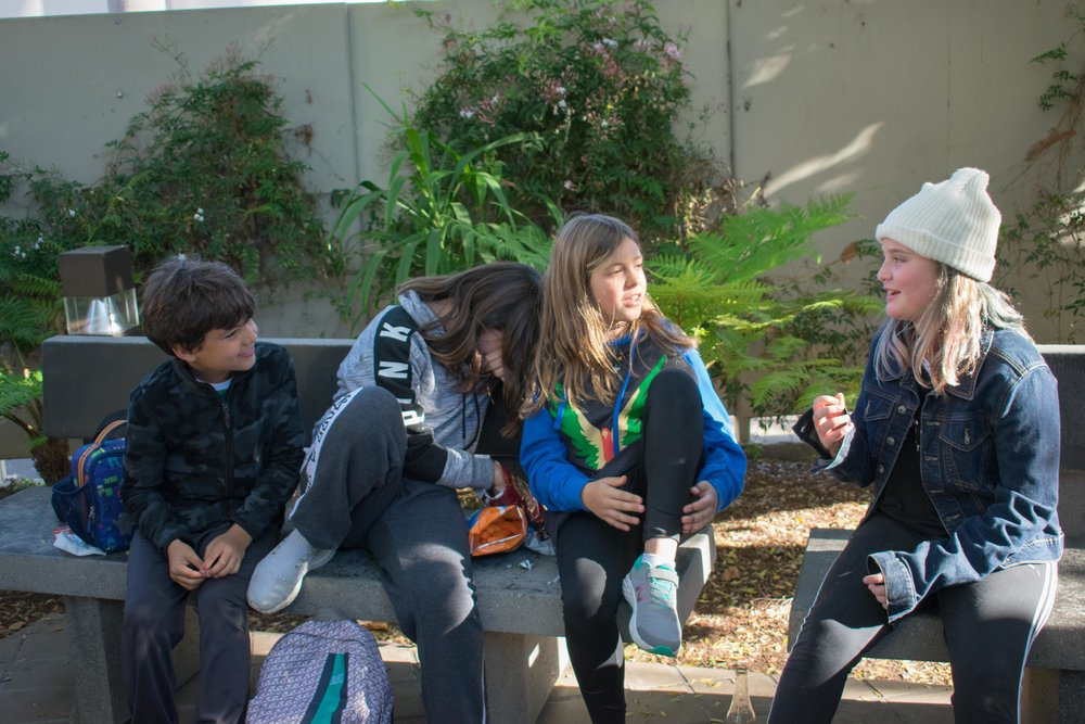 As the Montana Avenue Branch of the Santa Monica Public Library system celebrates its 58th anniversary, a few children take a break from tutoring, pictured from left to right are Tomas Peres (9), Mel Guerini (11), Valentine Peres (11), and Ridley Baxter (10) in Santa Monica, California. The library hosted a small event with cupcakes as well as old photos of the building in 1960 and several famous books and movies of the time. March 1, 2018. (Photo by: Ethan Lauren/Corsair Staff)