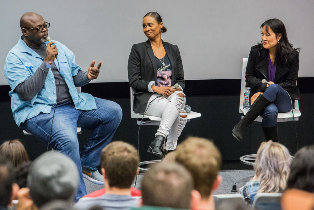 Charles Murray, one of the writers for 'Luke Cage' addresses the crowd and his fellow panelists Akela Cooper (middle) and Jenny Lynn (right) at the Writer Charles Murray, who has worked on shows such as Sons of Anarchy and Luke Cage, addresses the audience at the 'Inclusion in TV: A Q&A with Marvel and DC television writers' event held at Santa Monica College, Santa Monica, CA on Wednesday February 28 2018. (Photo by Ruth Iorio)