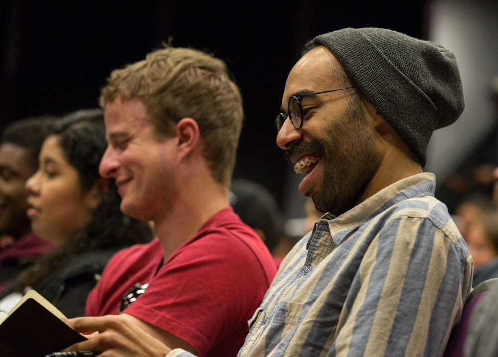 "Santa Monica College student film major James Healey laughs while taking notes during the lecture Series ""Inclusion in TV: Q&A with Marvel and DC Comics Television Writers"" that is being presented by the Santa Monica Community College Media and Communication Studies departments in the Santa Monica College Center for Media Design campus lecture hall in Santa Monica Calif., on Wednesday, February 28, 2018. Writer Akela Cooper (Marvel's Luke Cage, American Horror Story: Cult, The 100), Jenny Lynn (DC Comics' Arrow, Serenity, Daybreak), and Charles Murray (Marvel's The Inhumans, Marvel's Luke Cage, Sons of Anarchy, HBO's Oscar Micheaux biopic) discuss how their respective backgrounds enhance storytelling in the world of Marvel, DC Comics, and 21st-century Hollywood. (Corsair Photo: Matthew Martin)"