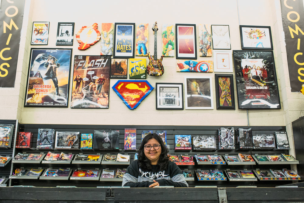 Jennifer Lopez, an employee of Southern California's oldest running comic book store 'HI DE HO COMICS', poses in front of their merchandise at their Santa Monice store in Santa Monica, CA on Thursday March 1 2018. (Photo by Ruth Iorio)