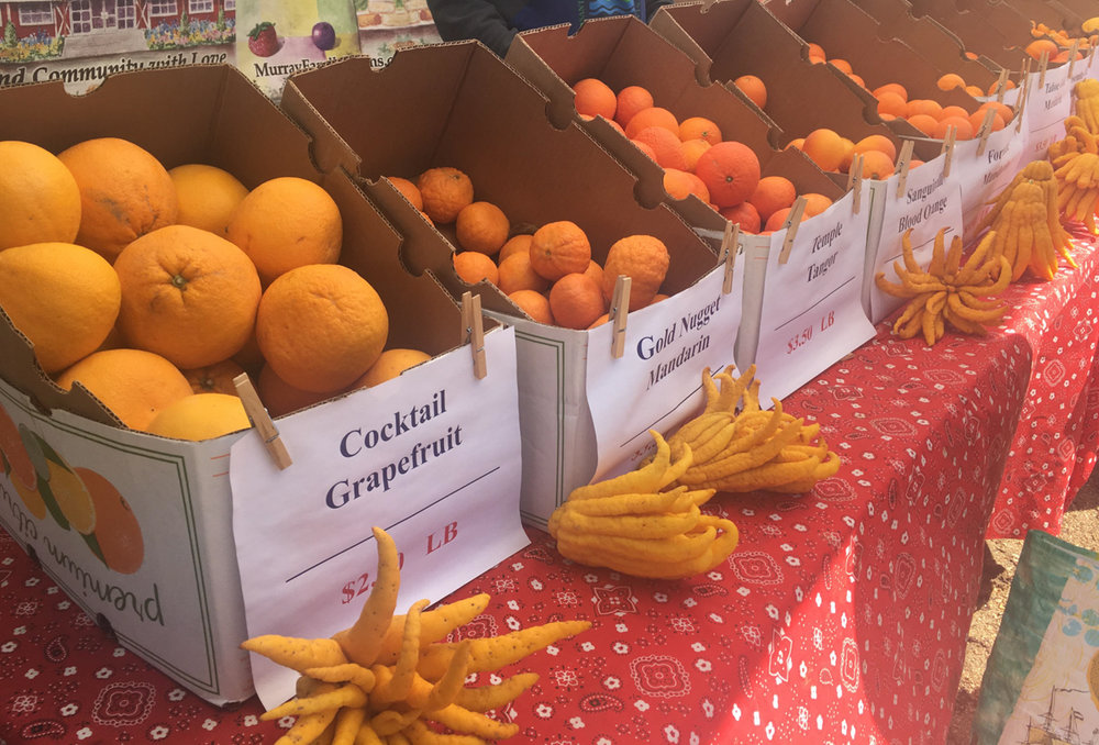 """The wide selection of exotic citrus fruits along with the unusual """"Buddha's Hand"""" in the front that many customers stopped to ask about, sold by Murray Family Farm at the farmers market in Virginia Avenue Park in Santa Monica, Calif. on March 3, 2018. (Photo by: Claudia Vardoni)"""