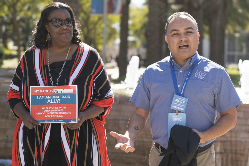 "Nick Mata (right), Director of Programs at Santa Monica College, (SMC) gives a speech on Monday, March 5, 2018 on SMC's main campus in Santa Monica, Calif. at the start of the DACA Day of Action event. Wendi DeMorst (cq) (left), Director of Supplemental Instruction and Tutoring Programs says she is an ally and wants undocumented students to know, ""You matter and you're important. What your dreams are, I want to support that."" (Photo: Helena Sung)"